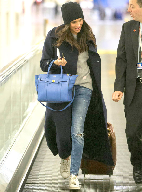 Meghan Leaves Heathrow in Casual Jeans & Cashmere