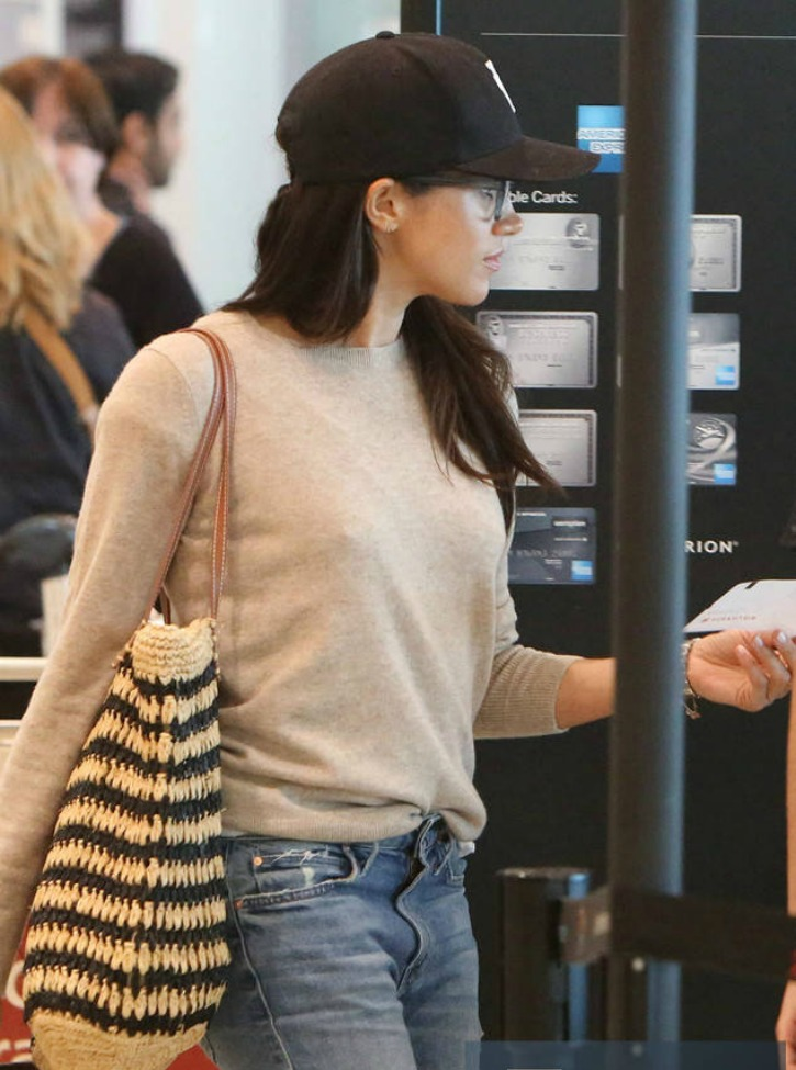 Meghan Flies out of Toronto in Casual Airport Style