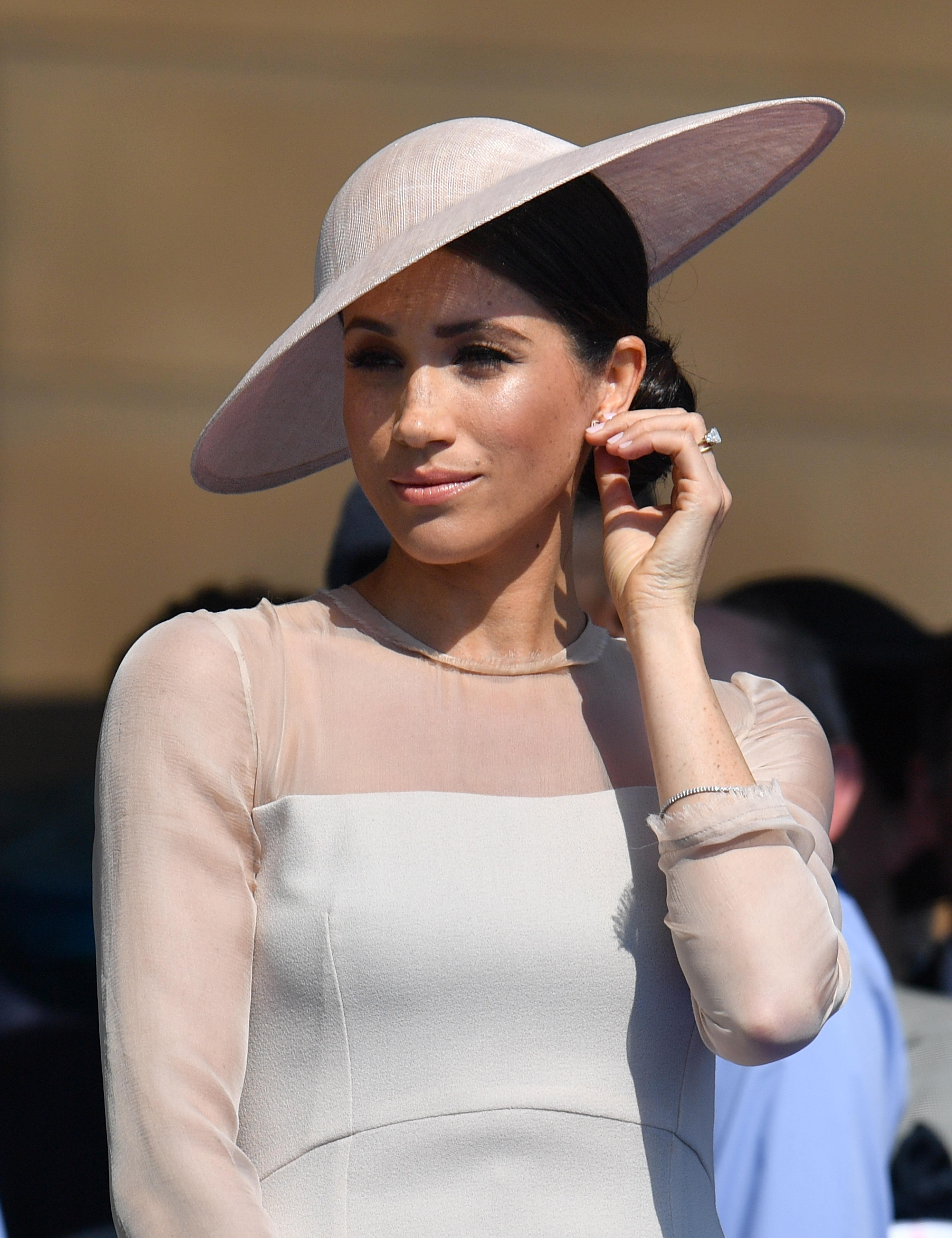 The Duchess of Sussex at a garden party at Buckingham Palace in London which she is attending as her first royal engagement after being married. The garden party was to mark the forthcoming 70th birthday of The Prince of Wales.